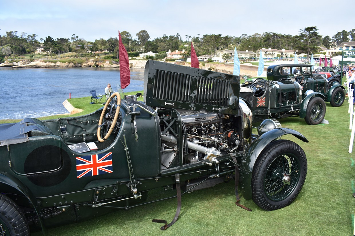 Bentleys line up along the 18th fairway at Pebble Beach