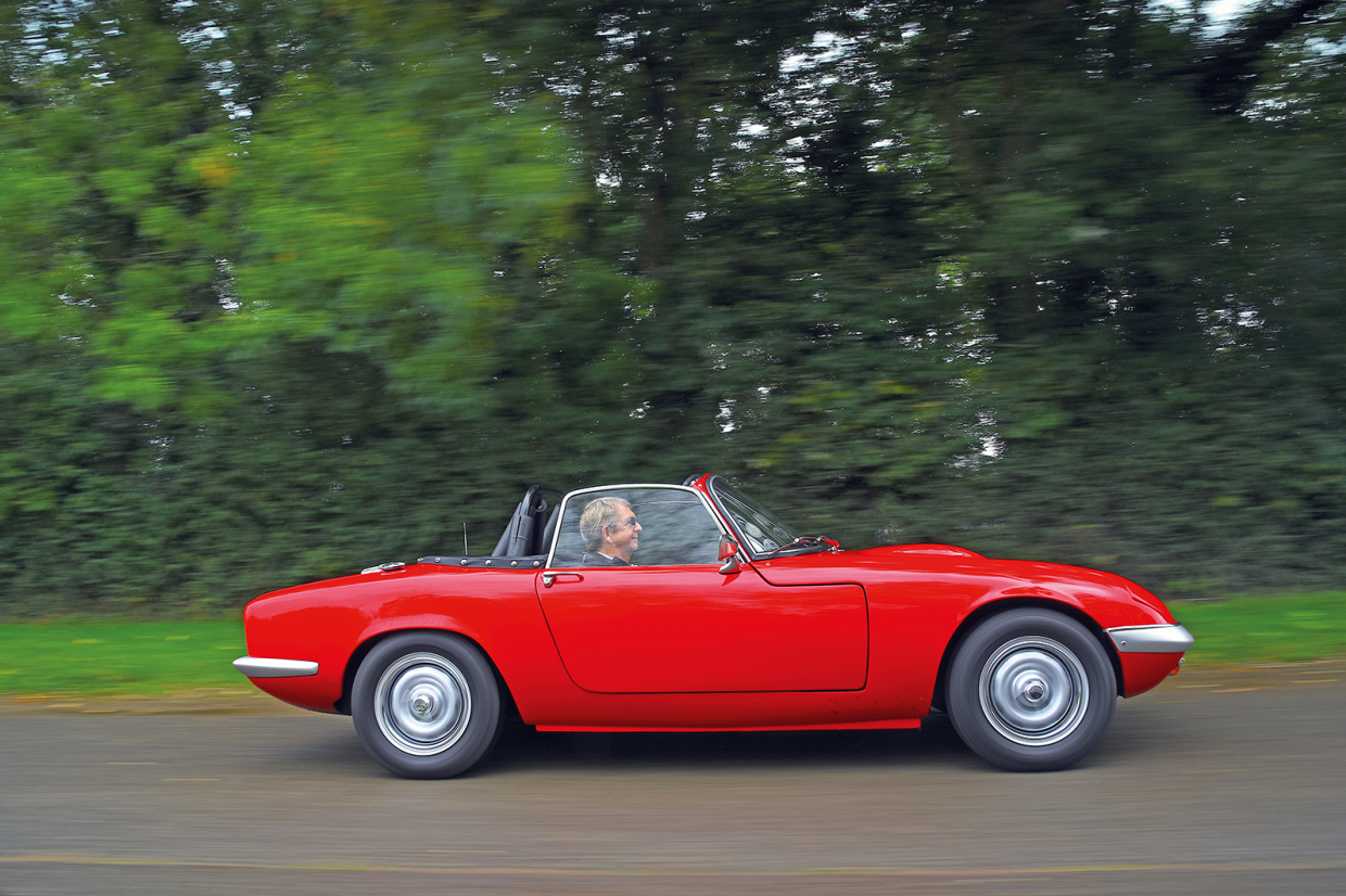 Behind the wheel of this red Lotus Elan