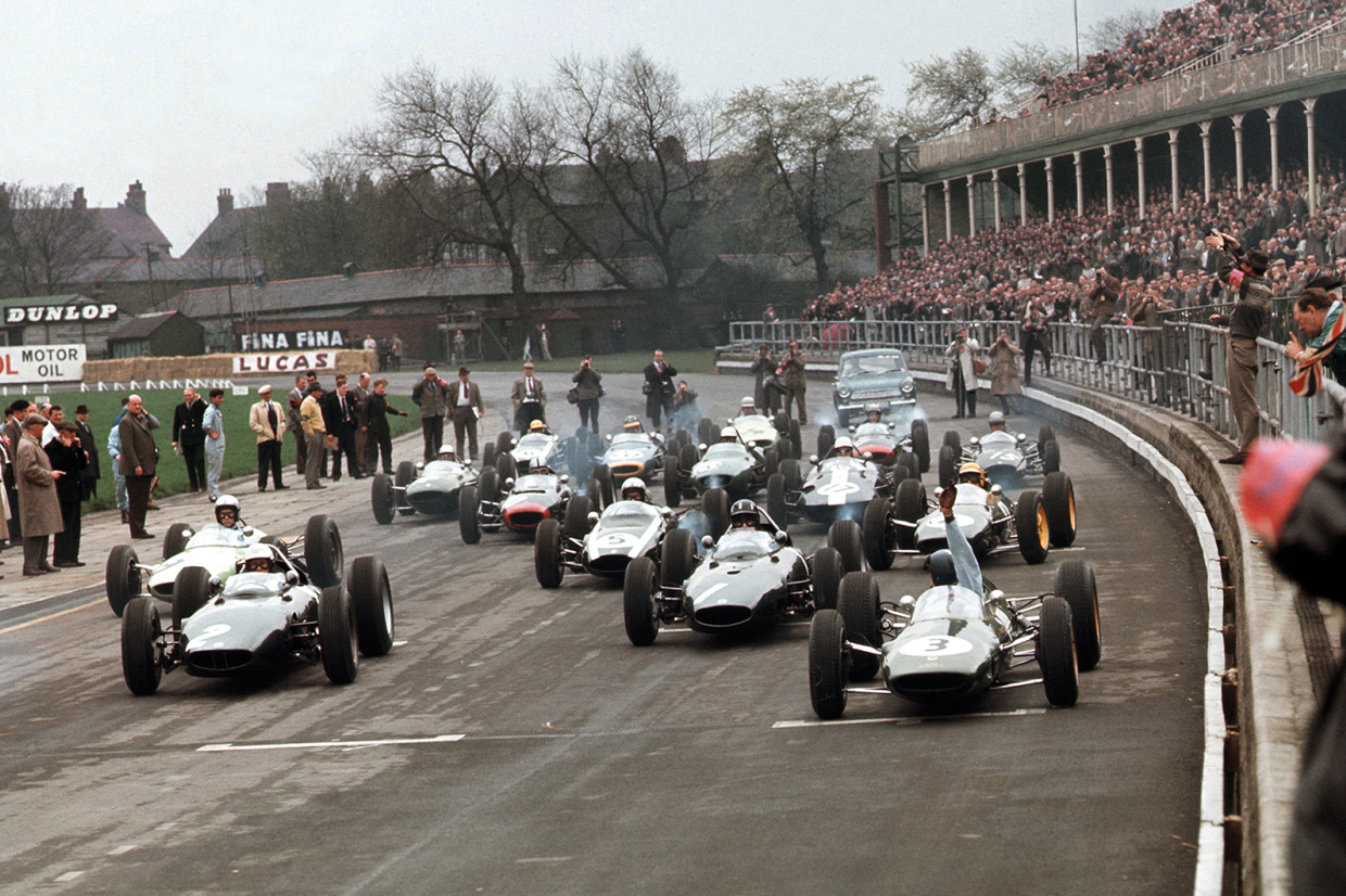 At Aintree on 27 April 1963, Jim Clark raises his hand as his Lotus 25-Climax fails to fire at the start