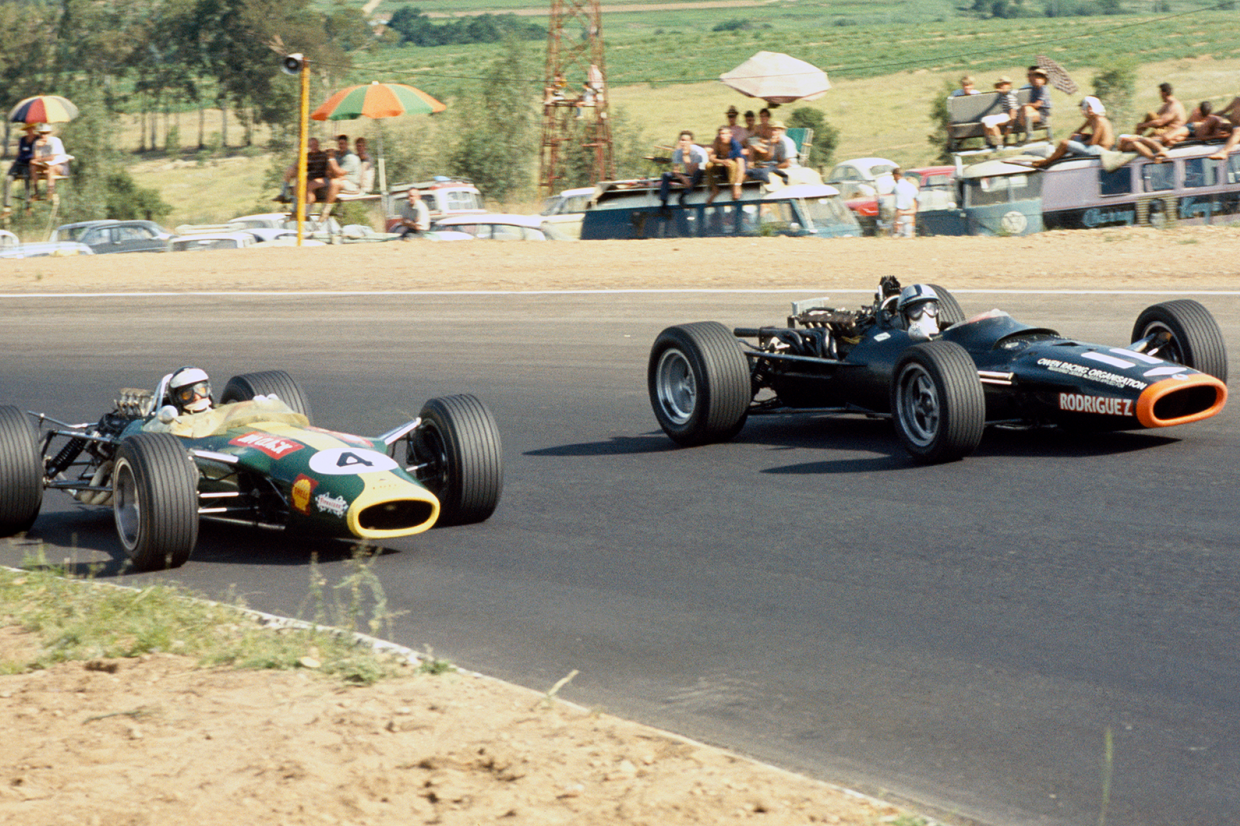 Jim Clark (left, Lotus 49-Ford) passes Pedro Rodríguez (BRM P126) at a sun-kissed Kyalami on New Year's Day 1968
