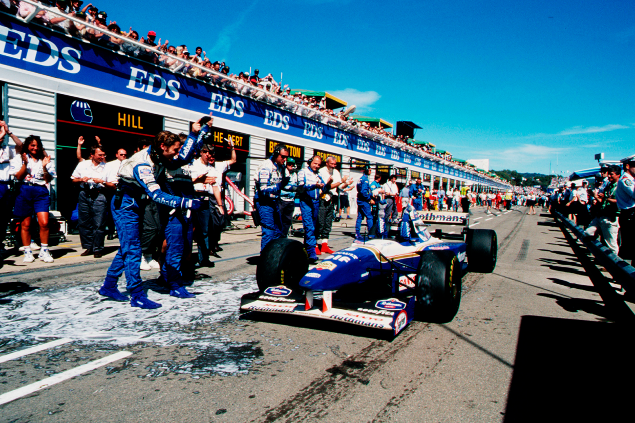 Damon Hill celebrates a 1995 season-ending victory in Adelaide with his team…